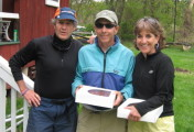 Host Cliff contratulates 3rd Place Mark and Susan